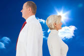 Older couple standing not facing each other — Stock Photo