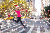 Festive blonde skipping and smiling — Stock Photo