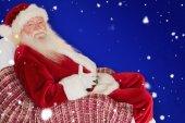 Santa holding his belly — Stock Photo