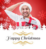 Festive man holding christmas gifts — Stock Photo
