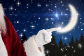 Santa Claus points at something — Stock Photo