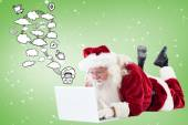 Santa lies in front of his laptop — Stock Photo