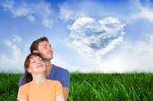 Happy couple together looking upwards — Stock Photo