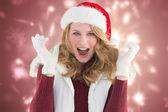 Blonde woman in santa hat screaming — Stock Photo