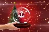 Hand holding snow globe — Stock Photo