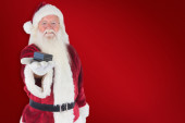 Santa shows a little box — Stock Photo