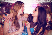 Composite image of friends drinking champagne — Stock Photo