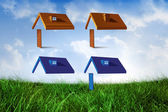 House structures against field of grass — Stock Photo