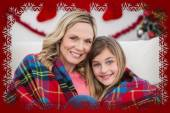 Mother and daughter wrapped in blanket — Stock Photo
