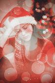 Festive brunette feeling sad at christmas — Foto de Stock