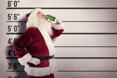 Father Christmas drinks beer — Stock Photo