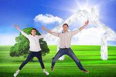 Paar springen en hand in hand — Stockfoto