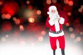 Santa holding sack and keeping a secret — Stock Photo