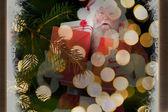 Santa carries a few presents — Stock Photo