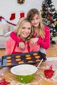 Festive little girl making christmas cookies — Stockfoto