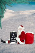 Santa sits with board — Photo