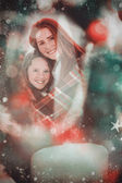 Festive mother and daughter wrapped in blanke — Stock Photo