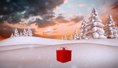 Composite image of red present — Stock Photo
