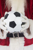 Santa holds classic football — Foto Stock