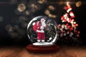 Santa asking for quiet in snow globe — Stock Photo