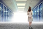 Businesswoman against server hallway — Stock Photo