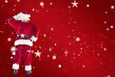 Santa Claus against red snowflake — Stock Photo