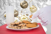 Hand of santa taking cookie — Foto de Stock