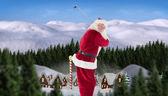 Santa Claus swings his golf club — Stok fotoğraf