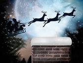 Santa flying his sleigh — Stockfoto