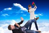 Woman throwing roses at man — Stock Photo