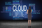 Businesswoman against cloud computing buzzwords — Stock Photo