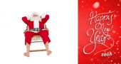 Happy santa relaxing on deckchair — Stock Photo