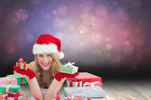 Woman in santa hat laying on the floor while — Stock Photo