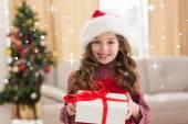 Festive little girl opening gift — Stock Photo