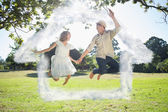 Cute couple jumping in the park together hold — Stock Photo
