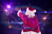 Santa Claus points at something — Stock Photo