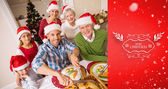 Father in santa hat carving chicken — Stock Photo