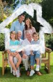 Smiling multi generation family sitting — Stock Photo