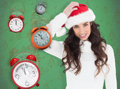 Confused brunette in santa hat — Stock Photo