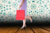 Composite image of mid section of woman holding red shopping bag — Stock Photo