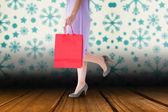 Composite image of mid section of woman holding red shopping bag — Foto de Stock