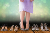 Composite image of mid section of woman in dress with heels — Stock Photo