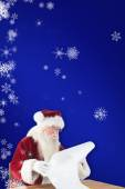 Santa reads long list — Stock Photo