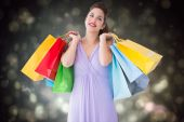 Thoughtful brunette holding shopping bags — Stock Photo