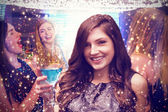 Composite image of brunette with cocktail — Stock Photo