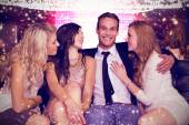Composite image of girls flirting with young man — Stock Photo