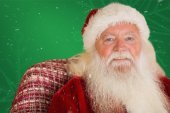 Father christmas sitting on couch — Stock Photo