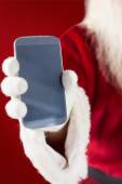 Santa claus showing smartphone — Stock Photo