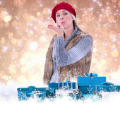 Blonde in winter clothes blowing kiss — Stock Photo