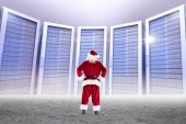 Santa standing with hands on hips — Stock Photo
